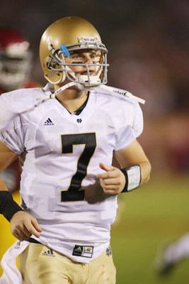 LOS ANGELES - NOVEMBER 29:  Jimmy Clausen #7 of the Notre Dame Fighting Irish walks on the field against the USC Trojans on November 29, 2008 at the Los Angeles Memorial Coliseum in Los Angeles, California.  USC won 38-3.  (Photo by Jeff Golden/Getty Imag