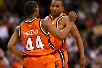 WINSTON-SALEM, NC - MARCH 03:  Teammates J.R. Reynolds #2 and Sean Singletary #44 of the Virginia Cavaliers celebrate after a basket against the Wake Forest Demon Deacons on March 3, 2007 at Lawrence Joel Coliseum in Winston Salem, North Carolina.  (Photo