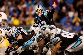 CHARLOTTE, NC - JANUARY 10:  Quarterback Jake Delhomme #17 of the Carolina Panthers signals to a teammate while lined up against the Arizona Cardinals defense during the NFC Divisional Playoff Game on January 10, 2009 at Bank of America Stadium in Charlot