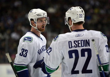 ANAHEIM, CA - MARCH 11:  Henrik Sedin #33 of the Vancouver Canucks has a word with teammate and brother Daniel Sedin #22 during a break in NHL game action against the Anaheim Ducks at Honda Center on March 11, 2009 in Anaheim, California. The Ducks defeat