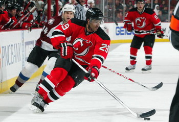 NEWARK, NJ - FEBRUARY 26:  Johnny Oduya #29 of the New Jersey Devils skates against the Colorado Avalanche at the Prudential Center on February 26, 2009 in Newark, New Jersey. The Devils defeated the Avalanche 4-0.  (Photo by Jim McIsaac/Getty Images)