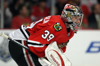 CHICAGO - MAY 22:  Goalie Nikolai Khabibulin #39 of the Chicago Blackhawks tends goal against the Detroit Red Wings during Game Three of the Western Conference Championship Round of the 2009 Stanley Cup Playoffs on May 22, 2009 at the United Center in Chi