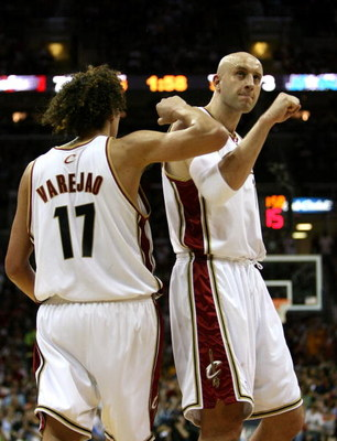 CLEVELAND - MAY 28:  Zydrunas Ilgauskas #11 and Anderson Varejao #17 of the Cleveland Cavaliers react after a play against the Orlando Magic in Game Five of the Eastern Conference Finals during the 2009 Playoffs at Quicken Loans Arena on May 28, 2009 in C