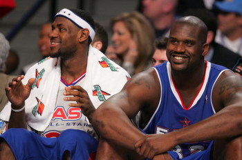 DENVER - FEBRUARY 20:   (L-R) LeBron James #23 and Shaquille O'Neal #32 of the Eastern Conference All-Stars smile on the bench in the final moments of the East's win over the Western Conference All-Stars the 54th All-Star Game, part of 2005 NBA All-Star W