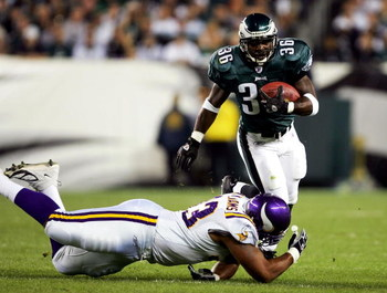 PHILADELPHIA - SEPTEMBER 20:  Brian Westbrook #36 of the Philadelphia Eagles is hit by Kevin Williams #93 of the Minnesota Vikings at Lincoln Financial Field on September 20, 2004 in Philadelphia, Pennsylvania. (Photo by Ezra Shaw/Getty Images)