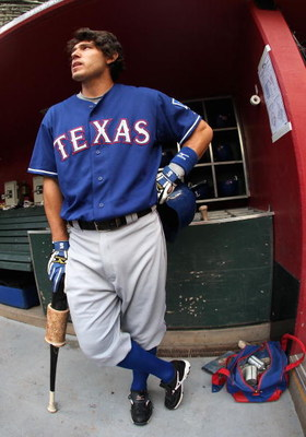 PHOENIX - JUNE 23:  Ian Kinsler #5 of the Texas Rangers stands in the dugout before the major league baseball game against the Arizona Diamondbacks at Chase Field on June 23, 2009 in Phoenix, Arizona. The Diamondbacks defeated the Rangers 8-2.  (Photo by