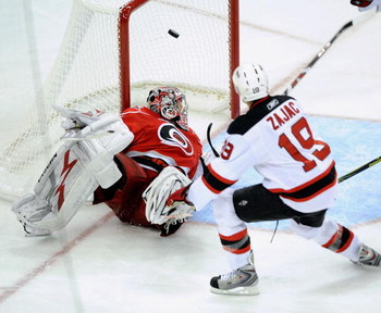 RALEIGH, NC - APRIL 19:  Travis Zajac #19 of the New Jersey Devils celebrates after scoring the game-wining goal in overtime against the Carolina Hurricanes during Game Three of the Eastern Conference Quarterfinals of the 2009 Stanley Cup Playoffs on Apri
