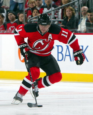 NEWARK, NJ - APRIL 23:  John Madden #11 of the New Jersey Devils skates against the Carolina Hurricanes during Game Five of the Eastern Conference Quarterfinal Round of the 2009 NHL Stanley Cup Playoffs on April 23, 2009 at the Prudential Center in Newark