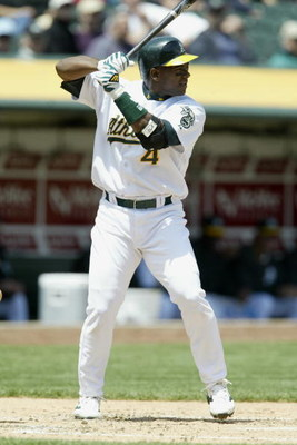OAKLAND, CA - MAY 8:  Miguel Tejada #4 of the Oakland Athletics at bat against the Chicago White Sox during the game at the Network Associates Coliseum on May 8, 2003 in Oakland, California.  The Athletics defeated the White Sox 8-5. (Photo by Jed Jacobso