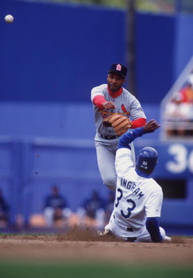 14 MAY 1995:  OZZIE SMITH, SHORTSTOP FOR THE ST. LOUIS CARDINALS, THROWS TO FIRST IN AN ATTEMPTED DOUBLE PLAY AS GAREY INGRAM OF THE LOS ANGELES DODGERS SLIDES IN TO SECOND BASE DURING THE CARDINALS'' 6-5 WIN IN 11 INNINGS AT DODGER STADIUM IN LOS ANGELES