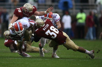 TALLAHASSEE, FL - NOVEMBER 29:  Receiver Jeffrey Demps #2 of the Florida Gators is brought down by linebacker Dekoda watson #36 of the Florida State Seminoles during the first half at Bobby Bowden Field at Doak Campbell Stadium on November 29, 2008 in Tal