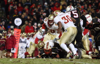 COLLEGE PARK, MD - NOVEMBER 22: DaRel Scott #23 of the Maryland Terrapins fumbles as Derek Nicholson #30 of the Florida State Seminoles prepares to recover the ball and run it in for a touchdown on November 22, 2008 at Byrd Stadium in College Park, Maryla