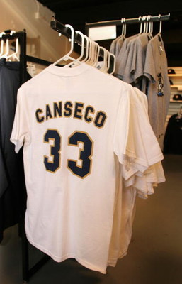 LONG BEACH, CA - JULY 14:  A Jose Canseco #33 tee shirt hangs on sale at the Golden Baseball League game between Long Beach Armada and the Fullerton Flyers on July 14,2006 at Blair Field in Long Beach, California.  (Photo By Christian Petersen/Getty Image