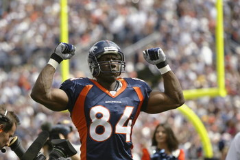 DENVER - SEPTEMBER 8:  Tight end Shannon Sharpe #83 of the Denver Broncos pumps his fists in the air as he is introduced to the crowd before the season opener against the St. Louis Rams on September 8, 2002 at Mile High Stadium in Denver, Colorado.  (Phot
