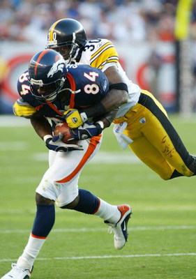 DENVER - OCTOBER 12: Shannon Sharpe #84 tight end for the Denver Broncos runs after a catch while Chad Scott #30 of the Pittsburgh Steelers tries to bring him down on October 12, 2003 at Invesco Field at Mile High in Denver, Colorado. (Photo by Michael Ma