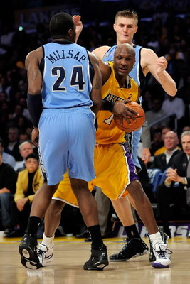 LOS ANGELES, CA - APRIL 27:  Lamar Odom #7 of the Los Angeles Lakers is double-teammed by Paul Millsap #24 and Andrei Kirilenko #47 of the Utah Jazz in the second quarter of Game Five of the Western Conference Quarterfinals during the 2009 NBA Playoffs at