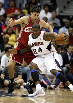 ATLANTA - MAY 11:  Marvin Williams #24 of the Atlanta Hawks drives into Wally Szczerbiak #10 of the Cleveland Cavaliers during Game Four of the Eastern Conference Semifinals during the 2009 NBA Playoffs at Philips Arena on May 11, 2009 in Atlanta, Georgia