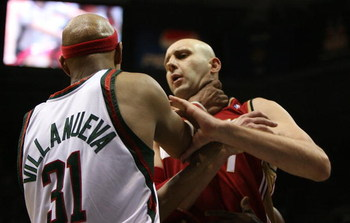 MILWAUKEE - FEBRUARY 20: Charlie Villanueva #31 of the Milwaukee Bucks grabs Zydrunas Ilgauskas #11 of the Cleveland Cavaliers by the throat on February 20, 2009 at the Bradley Center in Milwaukee, Wisconsin. The Cavaliers defeated the Bucks 111-103. NOTE