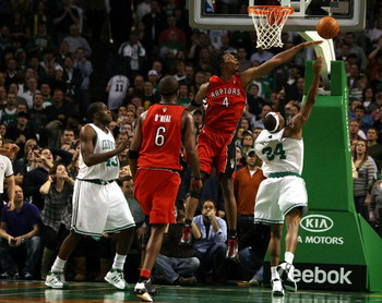 BOSTON - NOVEMBER 10:  Paul Pierce #34 of the Boston Celtics makes the shot despite the best effort of Chris Bosh #4 of the Toronto Raptors on November 10,  2008 at TD Banknorth Garden in Boston, Massachusetts. Kendrick Perkins of the Celtics and Jermaine