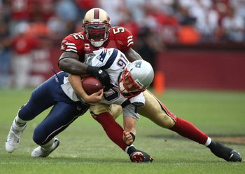 SAN FRANCISCO - OCTOBER 05:  Matt Cassel #16 of the New England Patriots is tackled by Patrick Willis #52 of the San Francisco 49ers during an NFL game on October 5, 2008 at Candlestick Park in San Francisco, California.  (Photo by Jed Jacobsohn/Getty Ima