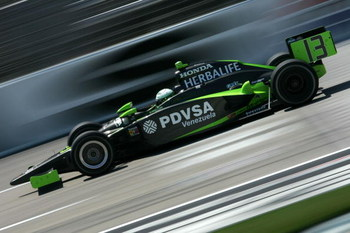 FORT WORTH, TX - JUNE 05:  E.J. Viso, driver of the #13 PDVSA HVM Racing Dallara Honda, practices for the IRL IndyCar Series Bombardier Learjet 550k on June 5, 2009 at Texas Motor Speedway in Fort Worth, Texas.  (Photo by Chris Trotman/Getty Images)