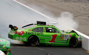 LOUDON, NH - JUNE 28:  Martin Truex Jr., driver of the #1 TomTom Chevrolet, loses control and hits wall during the NASCAR Sprint Cup Series LENOX Industrial Tools 301 at New Hampshire Motor Speedway on June 28, 2009 in Loudon, New Hampshire.  (Photo by Ch