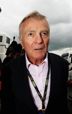 NORTHAMPTON, UNITED KINGDOM - JUNE 21:  F.I.A. President Max Mosley is surrounded by the media as he arrives in the paddock before the British Formula One Grand Prix at Silverstone on June 21, 2009 in Northampton, England.  (Photo by Paul Gilham/Getty Ima