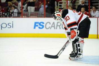 RALEIGH, NC - APRIL 21:  Goalie Martin Brodeur #30 of the New Jersey Devils reacts on the ice against the Carolina Hurricanes during Game Four of the Eastern Conference Quarterfinals of the 2009 Stanley Cup Playoffs on April 21, 2009 at the RBC Center in