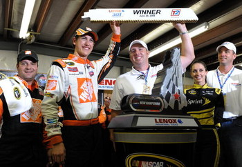 LOUDON, NH - JUNE 28:  Joey Logano, driver of the #20 Home Depot Toyota, celebrates winning the NASCAR Sprint Cup Series LENOX Industrial Tools 301 at New Hampshire Motor Speedway on June 28, 2009 in Loudon, New Hampshire. Logano won the rain shortened ra