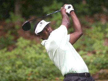 CROMWELL, CT - JUNE 26: Vijay Singh of Fiji watches the flight of his drive during round two of the 2009 Travelers Championship at TPC River Highlands on June 26, 2009 in Cromwell, Connecticut. (Photo by Jim Rogash/Getty Images)