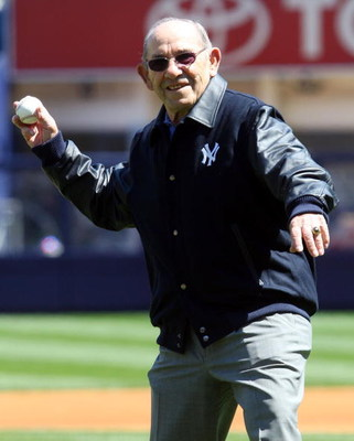 NEW YORK - APRIL 16: Yogi Berra throws the ceremonial first pitch before the opening day game between the Cleveland Indians and the New York Yankees at the new Yankee Stadium on April 16, 2009 in the Bronx borough of New York City. This is the first regul