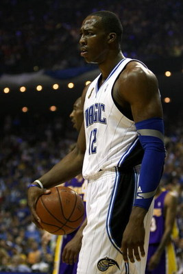 ORLANDO, FL - JUNE 14:  Dwight Howard #12 of the Orlando Magic reacts in the first quarter against the Los Angeles Lakers in Game Five of the 2009 NBA Finals on June 14, 2009 at Amway Arena in Orlando, Florida.  NOTE TO USER:  User expressly acknowledges