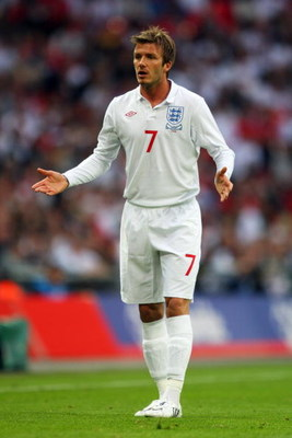 LONDON, ENGLAND - JUNE 10:  David Beckham of England speaks to a team mate during the FIFA 2010 World Cup Group 6 Qualifying match between England and Andorra at Wembley Stadium on June 10, 2009 in London, England.  (Photo by Mark Thompson/Getty Images)