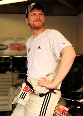 DAYTONA BEACH, FL - JULY 02:  Dale Earnhardt Jr, driver of the #88 National Guard/AMP Energy Chevrolet, stands in the garage during practice for the NASCAR Sprint Cup Series Coke Zero 400 at Daytona International Speedway on July 2, 2009 in Daytona Beach,