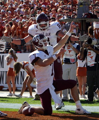 AUSTIN, TX - NOVEMBER 24:  Quarterback Stephen McGee #7 of the Texas A&M Aggies celebrates his touchdown with Joey Thomas #81 during a game against the Texas Longhorns at Darrell K Royal-Texas Memorial Stadium November 24, 2006 in Austin, Texas. The Aggie