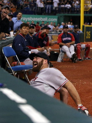 ST PETERSBURG, FL - OCTOBER 19:  Kevin Youkilis #20 of the Boston Red Sox reacts after attempting to catch a fould ball hit by the Tampa Bay Rays in game seven of the American League Championship Series during the 2008 MLB playoffs on October 19, 2008 at