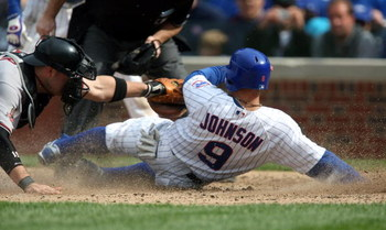 CHICAGO - MAY 10: Reed Johnson #9 of the Chicago Cubs is tagged out at the plate by Chris Synder #19 of the Arizona Diamondbacks in the 5th inning on May 10, 2008 at Wrigley Field in Chicago, Illinois. (Photo by Jonathan Daniel/Getty Images)