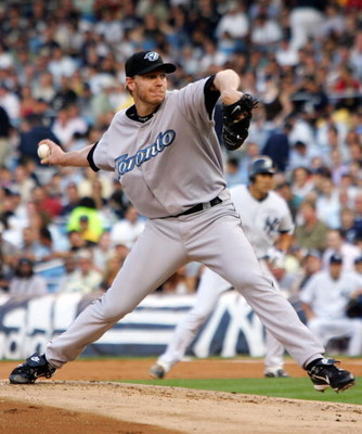 NEW YORK - JULY 17:  Roy Halladay #32 of the Toronto Blue Jays delivers a pitch against the New York Yankees during their game at Yankee Stadium on July 17, 2007 in the Bronx borough of New York City.  (Photo by Jim McIsaac/Getty Images)