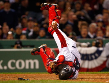 BOSTON - OCTOBER 13:  Catcher Jason Varitek #33 of the Boston Red Sox holds onto the ball after tagging out Carl Crawford (not pictured) of the Tampa Bay Rays at a play at the plate during game three of the American League Championship Series during the 2