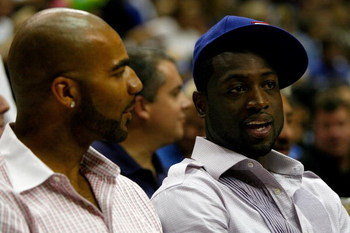ORLANDO, FL - JUNE 11:  US Olympic teammates Carlos Boozer of the Utah Jazz and Dwyane Wade of the Miami Heat sit together at Game Four of the 2009 NBA Finals between the Los Angeles Lakers and the Orlando Magic on June 11, 2009 at Amway Arena in Orlando,