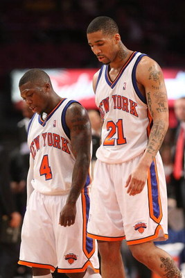 NEW YORK - MARCH 20:  Nate Robinson #4 of the New York Knicks walks from the court with teammate Wilson Chandler #21 against the Sacramento Kingson March 20, 2009 at Madison Square Garden in New York City. NOTE TO USER: User expressly acknowledges and agr