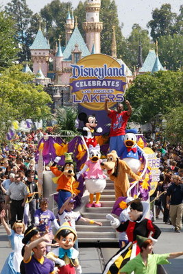 ANAHEIM, CA - JUNE 18:  In this handout provided by Disney, Lakers star and NBA Finals MVP Kobe Bryant waves to thousands of fans during a parade celebrating the 2009 World Champion Los Angeles Lakers at Disneyland on June 18, 2009 in Anaheim, California.