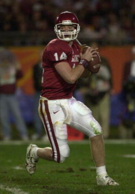 3 Jan 2001:  Quarterback Josh Heupel #14 of the Oklahoma Sooners rolls out of the pocket while playing the Florida State Seminoles during the Orange Bowl at Pro Player Stadium in Miami, Florida. DIGITAL IMAGE Mandatory Credit: Doug Pensinger/ALLSPORT