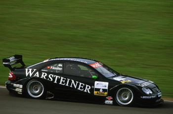 DONINGTON - MAY 19:  Warsteiner AMG Mercedes driver Marcel Fassler in action during the DTM German Touring Car Championship race held at Donington Park, in England on May 19, 2002. (Photo by: Bryn Lennon/Getty Images)