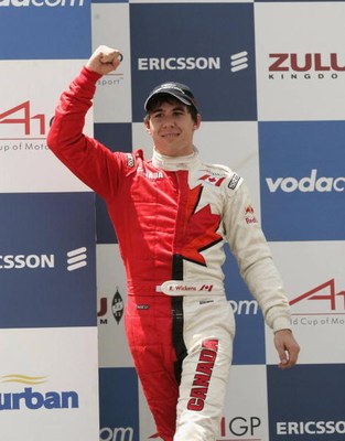 DURBAN, SOUTH AFRICA - FEBRUARY 24:  Canada's Robert Wickens celebrates on the podium after winning the A1GP Sprint Race on February 24, 2008 in Durban, South Africa.  (Photo by Tertius Pickard/Gallo Images/Getty Images)