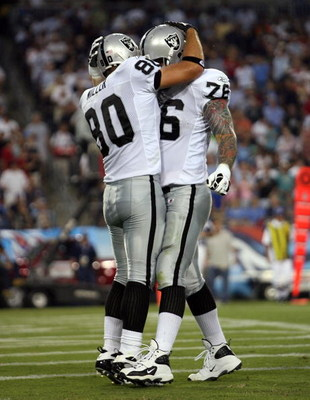 NASHVILLE, TN - AUGUST 15:  Zach Miller #80 of the Oakland Raiders celebrates with teammate Robert Gallery #76 after Miller caught a touchdown pass during the NFL pre-season game against the Tennessee Titans at LP Field August 15, 2008 in Nashville, Tenne