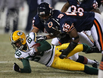 CHICAGO - DECEMBER 22: Lance Briggs #55 and Kevin Payne #44 of the Chicago Bears bring down Ruvell Martin #82 of the Green Bay Packers on December 22, 2008 at Soldier Field in Chicago, Illinois.  The Bears defeated the Packers 20-17 in overtime. (Photo by
