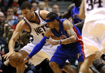 EAST RUTHERFORD, NJ - NOVEMBER 07:  Allen Iverson #1 of the Detroit Pistons and Brook Lopez #11 of the New Jersey Nets fight for a loose ball during their game November 7, 2008 at the Izod Arena in East Rutherford, New Jersey.  (Photo by Jeff Zelevansky/G