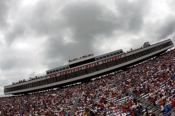 LOUDON, NH - JUNE 28:  Fans wait for the start of the NASCAR Sprint Cup Series LENOX Industrial Tools 301 under heavy rain clouds at New Hampshire Motor Speedway on June 28, 2009 in Loudon, New Hampshire.  (Photo by Chris Graythen/Getty Images)