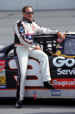 30 Apr 2000: Dale Earnhardt Sr. poses with his car during the NAPA Auto Parts 500, Part of the NASCAR Winston Cup Series, at the California Speedway in Fontana, California. Mandatory Credit: Jon Ferrey  /Allsport